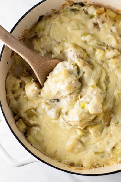 creamy potato casserole with leeks in a baking dish