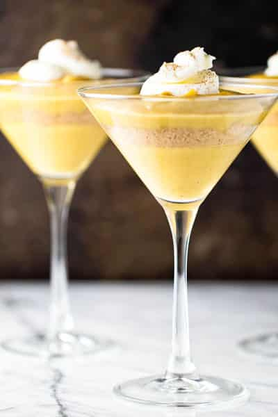 Pumpkin pudding parfaits in serving glasses and garnished with a dollop of whipped cream