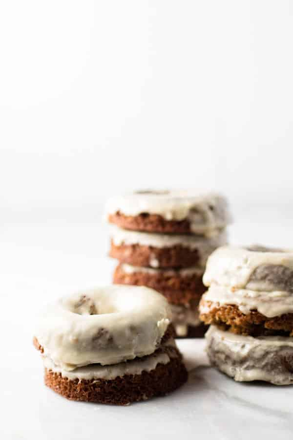 stacks of gingerbread baked donuts with maple glaze