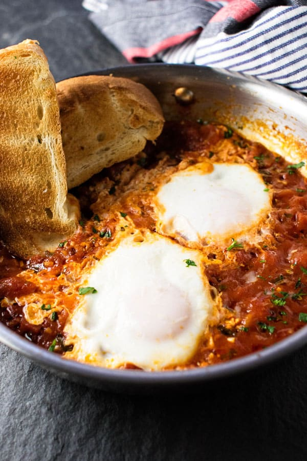 close-up photo of eggs in tomato sauce