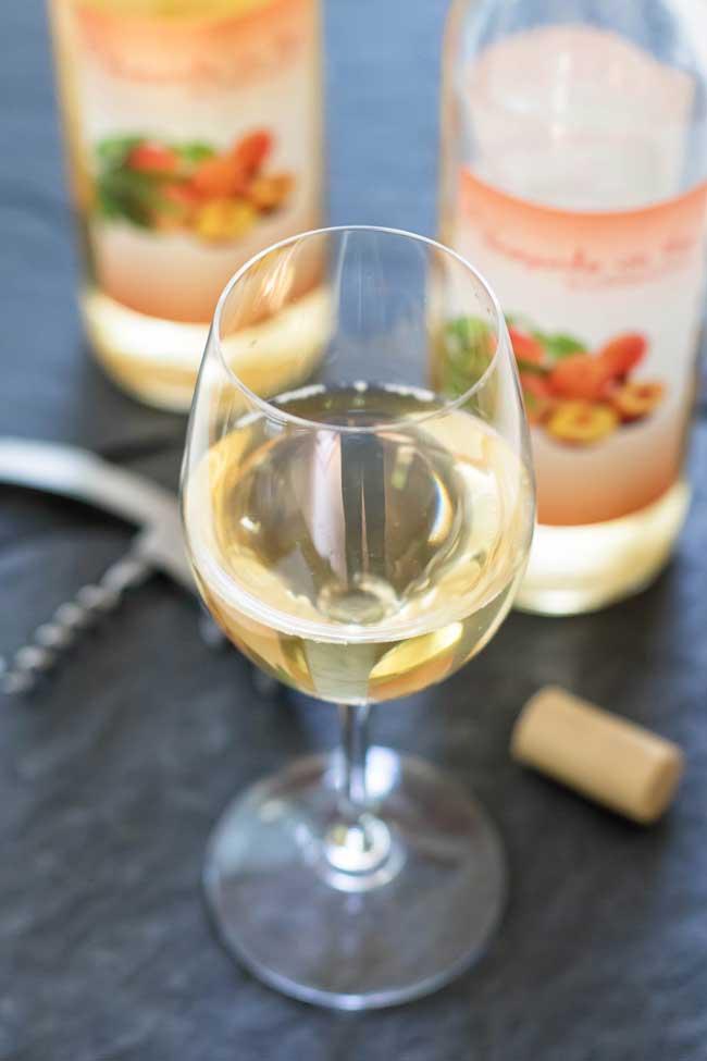 A glass of peach wine
