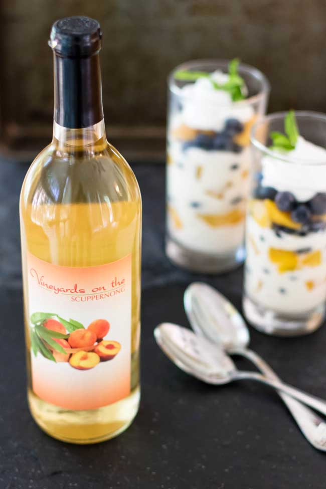A bottle of Peach White Wine with Ice Cream Parfaits
