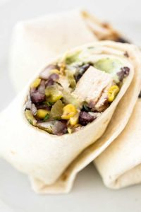 Southwest Chicken Wraps with black beans, green chile, and an avocado ranch dressing | girlgonegourmet.com