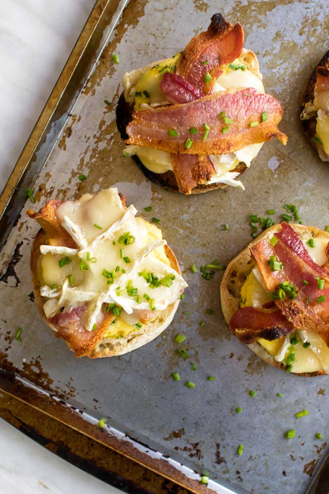 overhead photo of open faced bacon brie breakfast sandwiches
