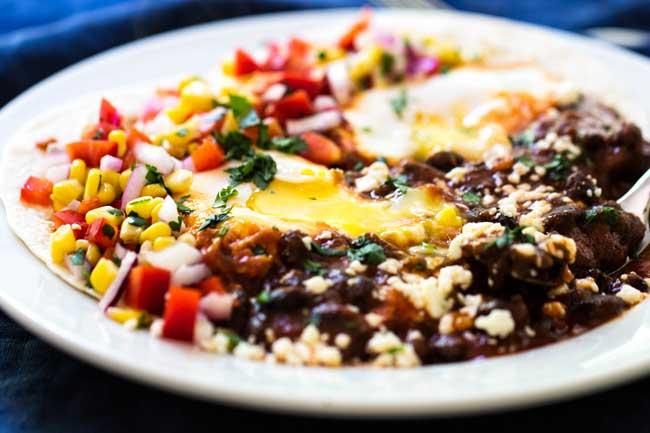 Huevos rancheros on a white plate