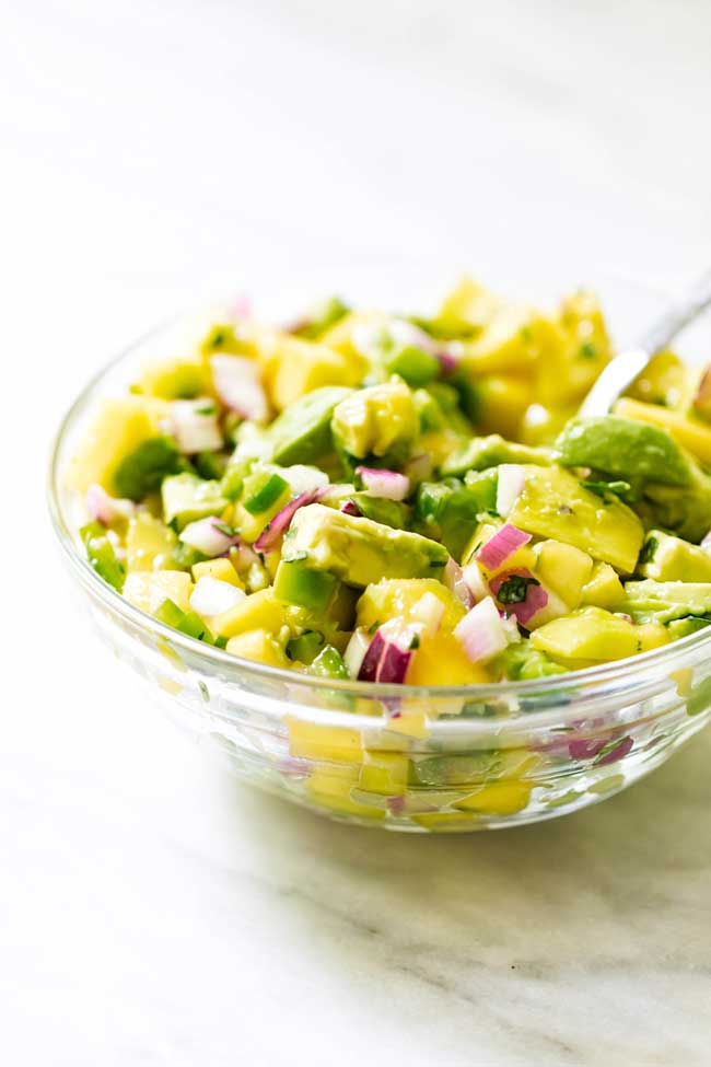 photo of a bowl of mango salsa
