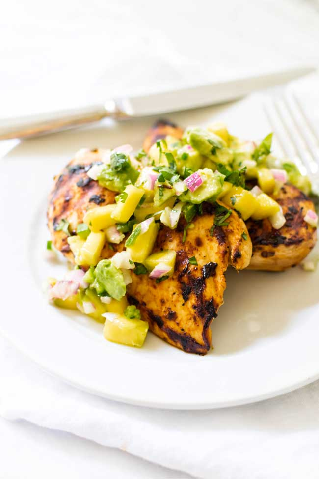 photo of grilled chicken topped with mango salsa