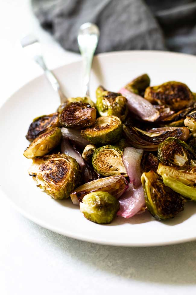 Roasted brussels sprouts and shallows on a serving dish
