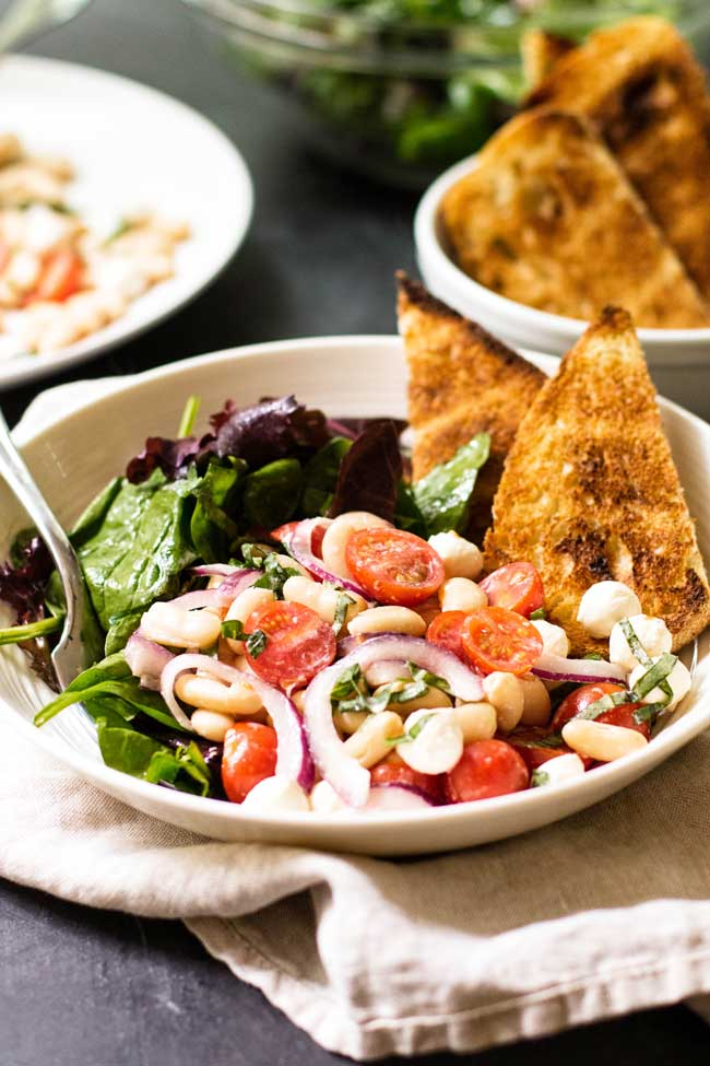 White Bean Tomato Salad with Toasted Bread in a bowl