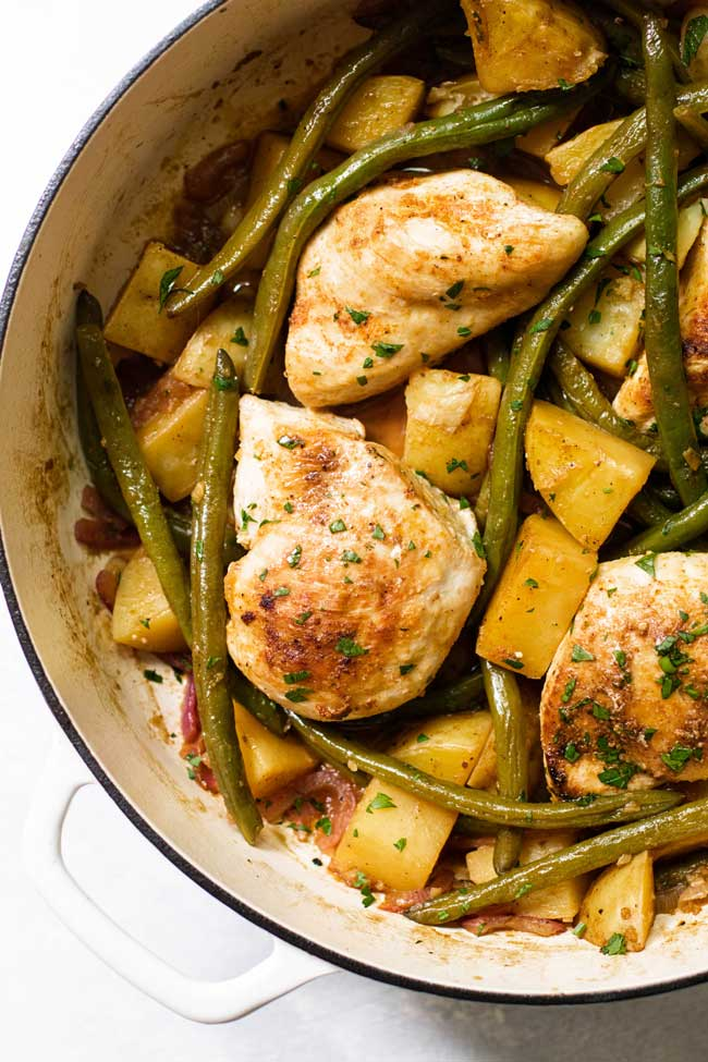 overhead photo of chicken with green beans and potatoes in a pan