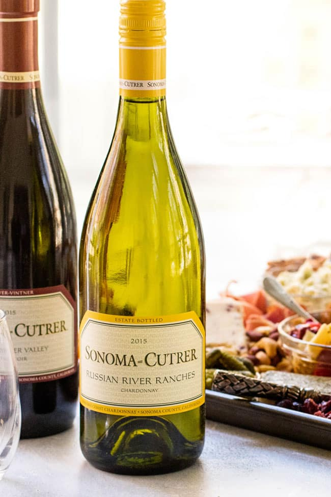 Red and White wine bottles to serve with the cheeseboard
