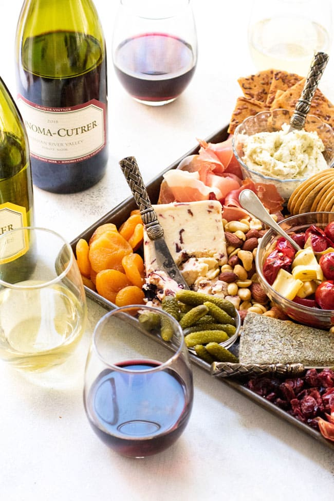 Holiday cheese board with wine
