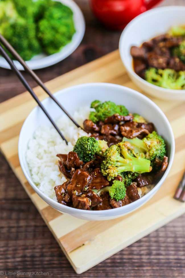 Beef and Broccoli with a bowl with rice