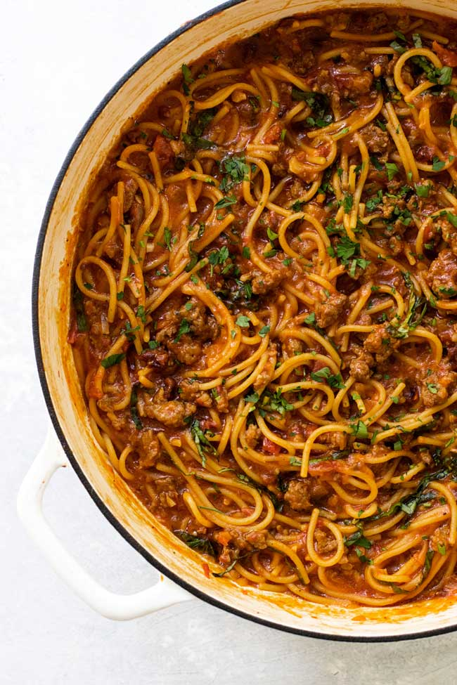 Spaghetti bolognese in a large white pan