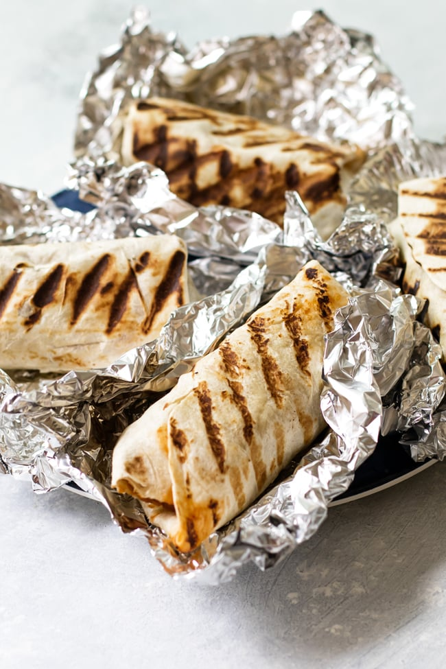 Tropical BBQ chicken wraps on tin foil