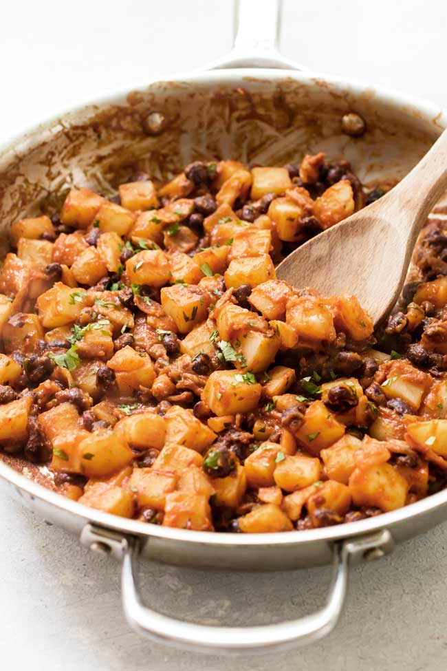 Step one is to make the black bean and potato filling in a skillet