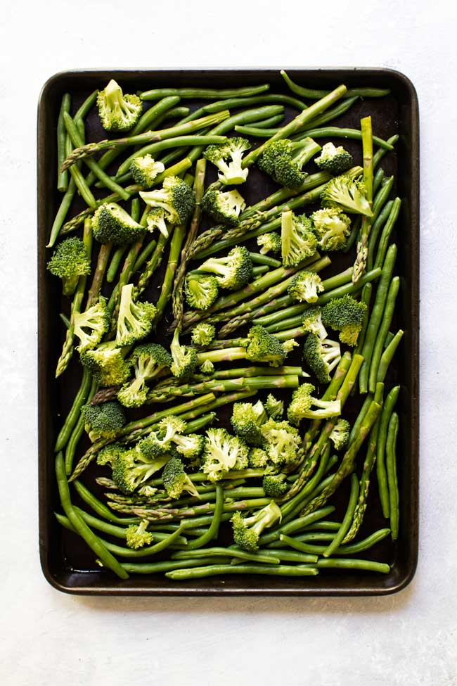 Broccoli, green beans, and asparagus on a sheet pan