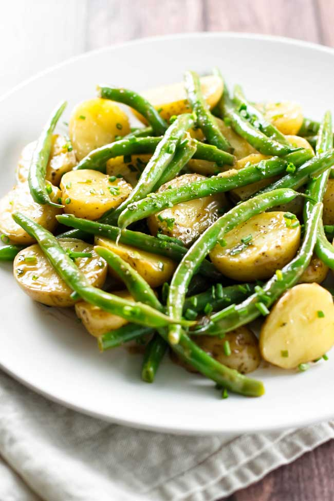 Green bean potato salad on a plate with a napkin