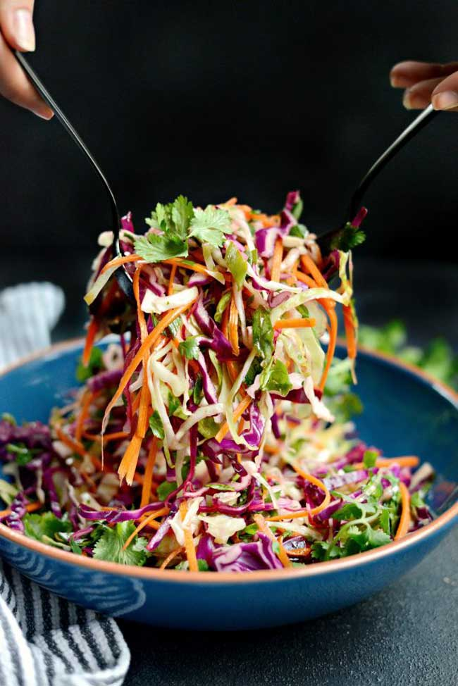 Summer Side Dishes: cilantro slaw with lime vinaigrette in a bowl with tongs