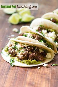 braised beef tacos on a cutting board