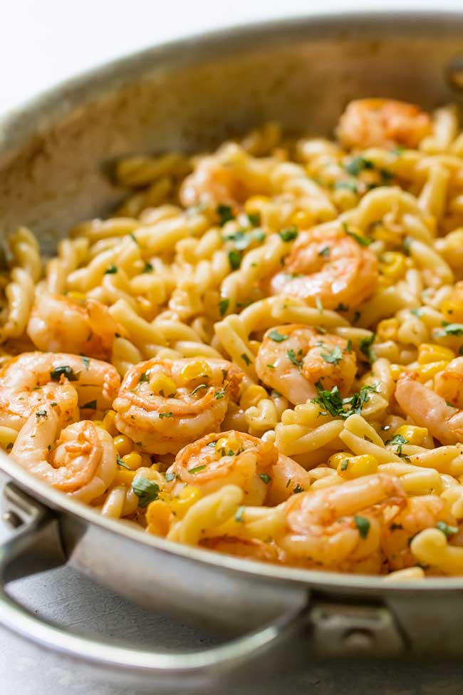 cilantro-butter shrimp pasta in a skillet