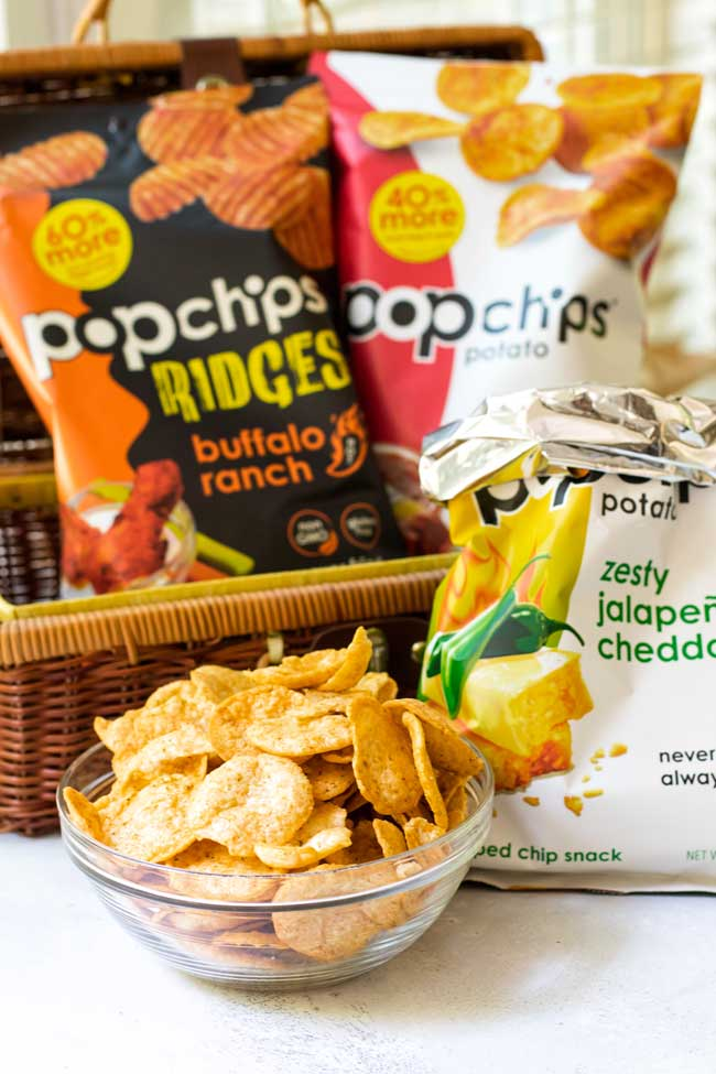 a bowl of popchips in a bowl with bags of popchips in the background