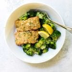 photo of honey mustard salmon in a bowl with steamed broccoli