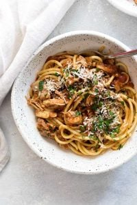 overhead photo of a bowl of spicy chicken ragu with bucatini