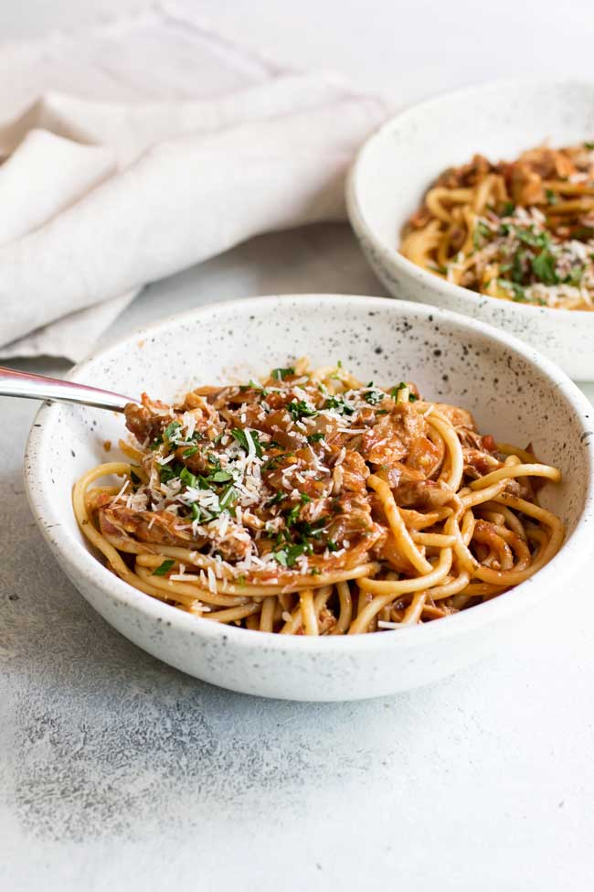 photo of two bowls of spicy chicken ragu