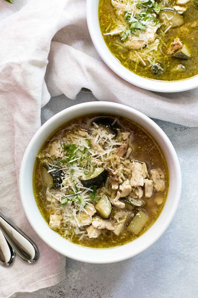 overhead photo of pesto chicken orzo soup
