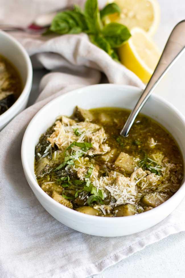 photo of a bowl of pesto chicken orzo soup