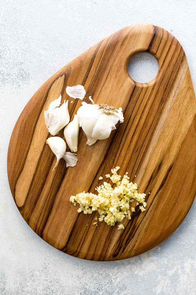 photo of chopped garlic on a cutting board