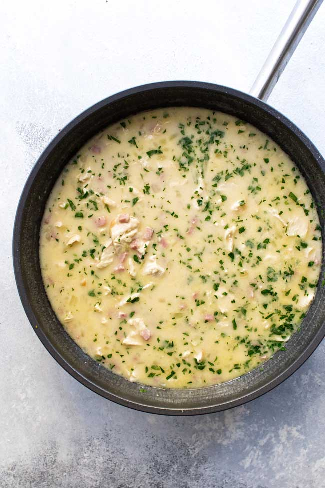 overhead photo of chicken cordon bleu soup in a large pan