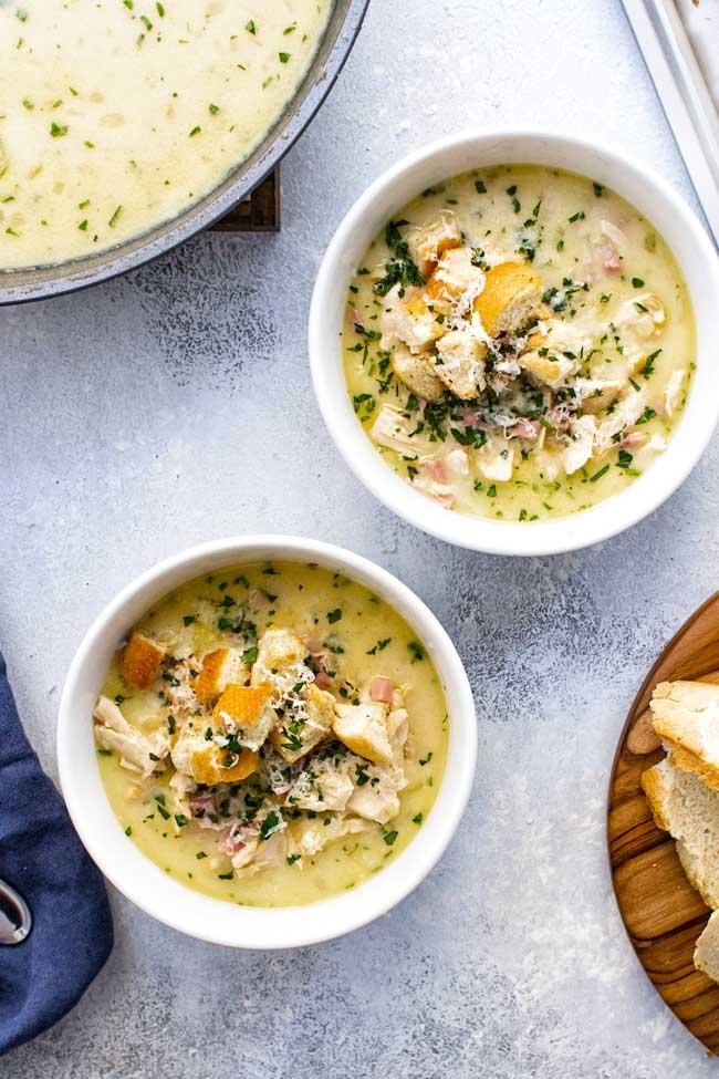 overhead photo of two bowls of chicken cordon bleu soup
