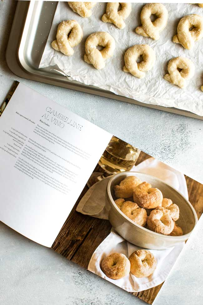 overhead photo of a cookbook and baking sheet with cookies ready to bake
