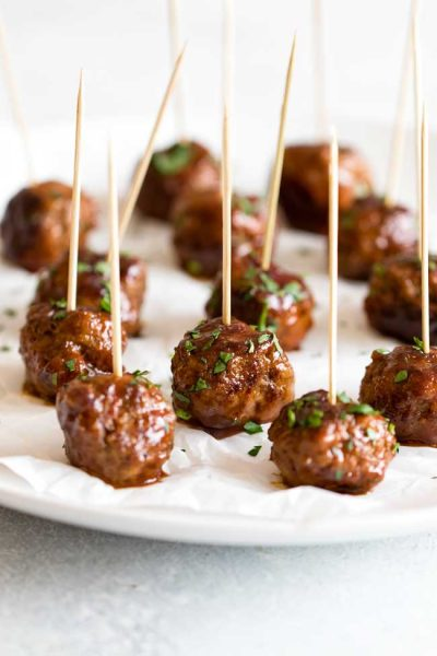 sweet & spicy meatball bites lined up on a plate