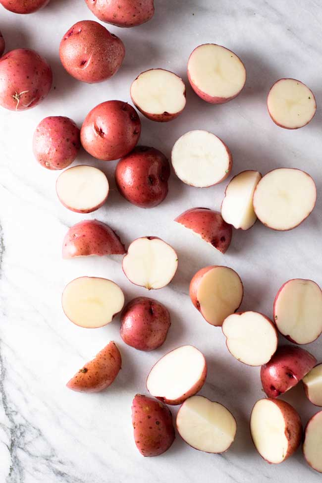 overhead photo of red potatoes being prepped