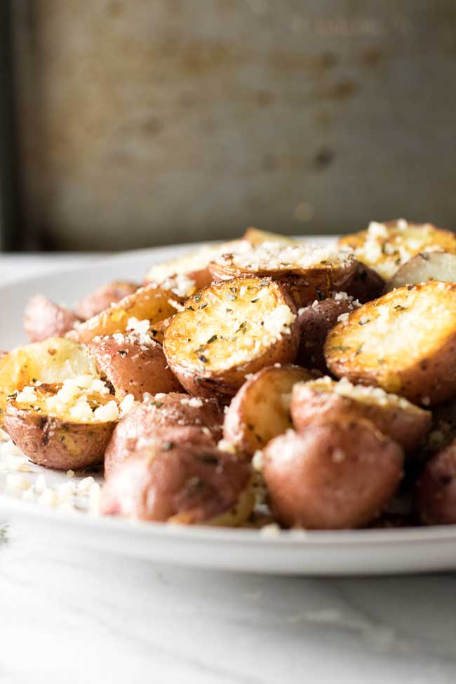close-up photo of roasted Parmesan potatoes on a plate