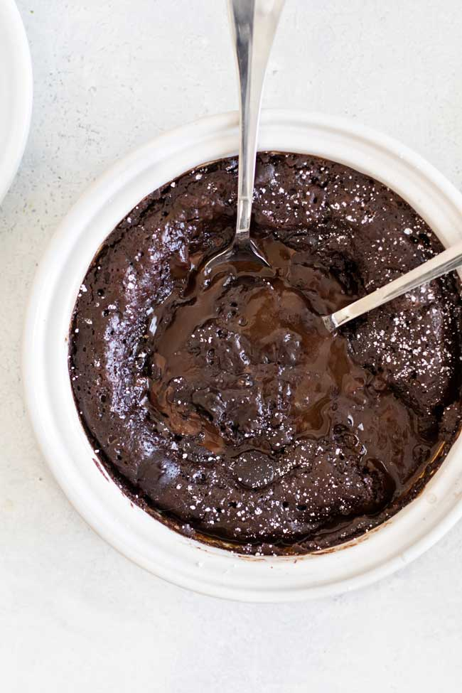 Overhead photo of a mocha pudding cake with two spoons