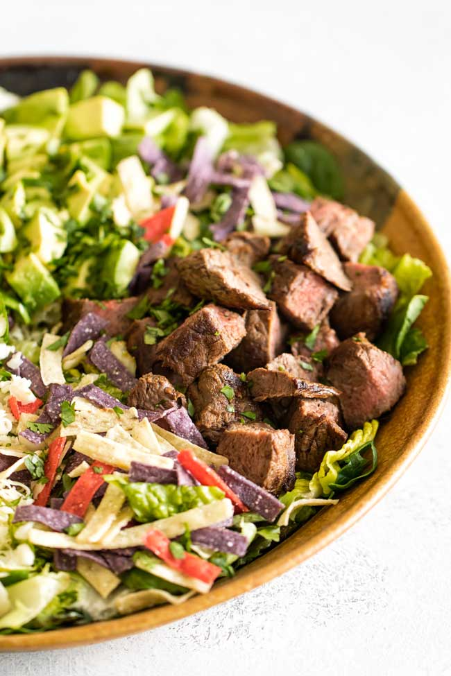 Close-up photo of a steak taco salad