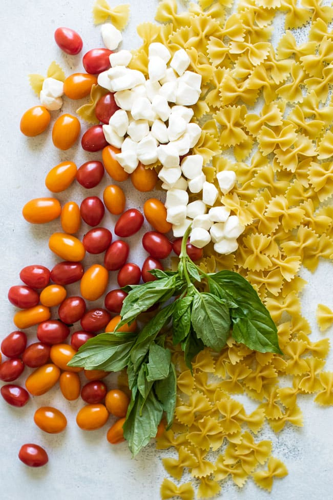 overhead photo of the ingredients for caprese pasta