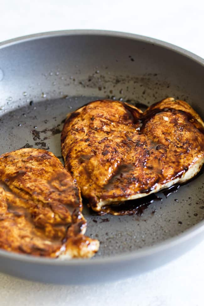 photo of balsamic glazed chicken in a skillet