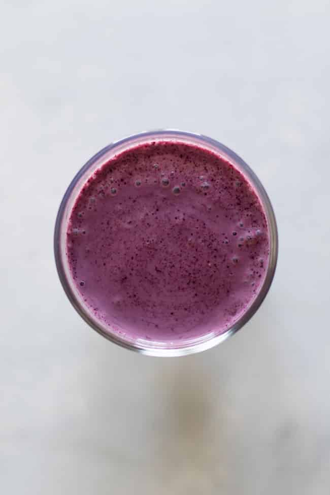 overhead photo of a blueberry smoothie