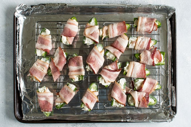 overhead photo of bacon wrapped jalapenos ready to go in the oven