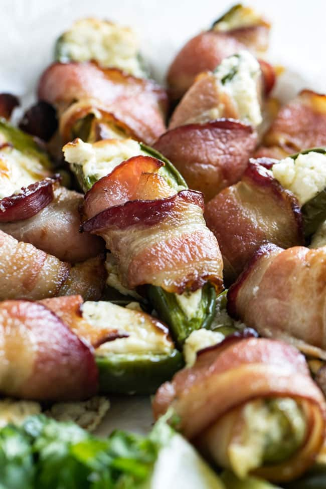 close-up photo of a plate of bacon wrapped jalapeno poppers