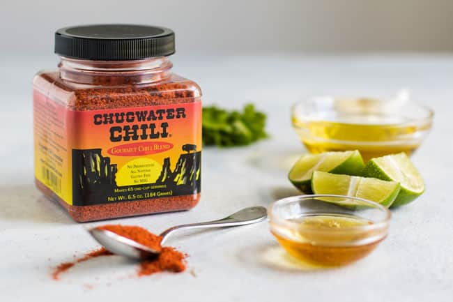 Photo of a container of chili seasoning with other ingredients for the marinade