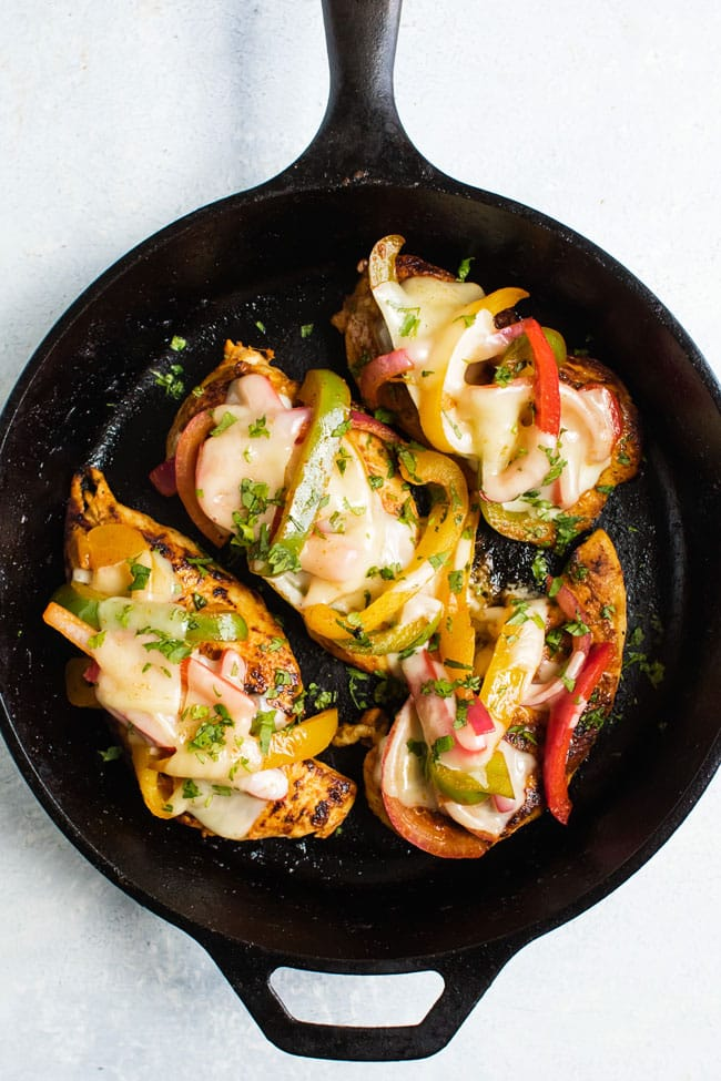 overhead photo of chicken topped with peppers and Monterrey jack cheese