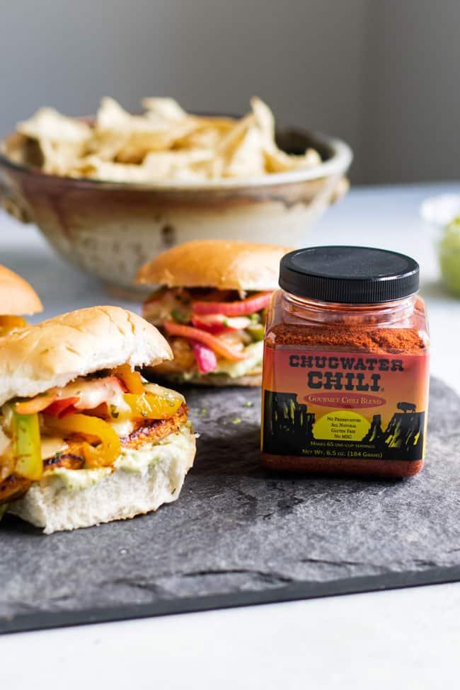 photo of fajita chicken burgers with a jar of chili seasoning
