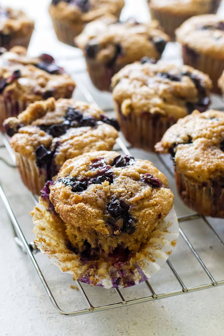 close-up photo of a blueberry buttermilk muffin on a baking rack