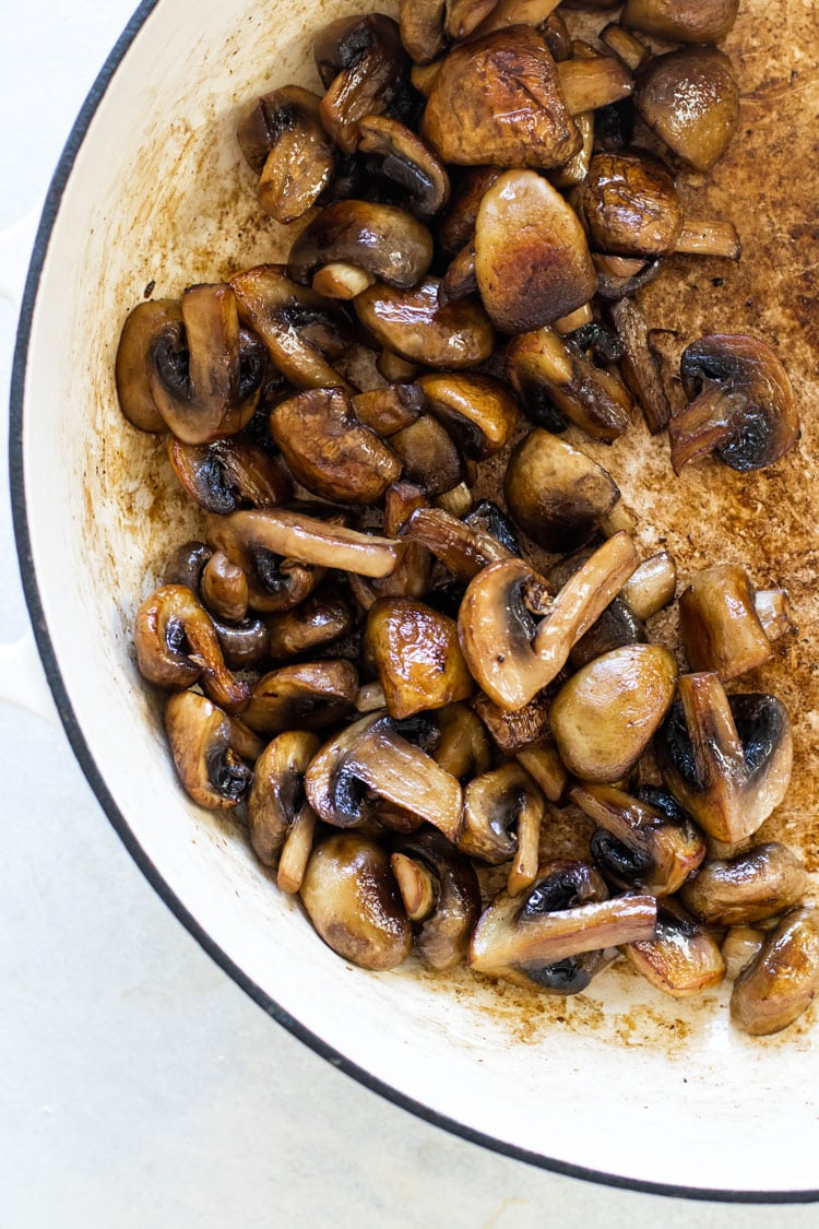 overhead photo of browned mushrooms in a pan